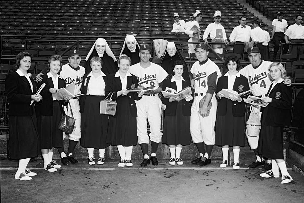 pose with students and nuns at the Academy of St. Aloysius, a Catholic girls' school in Jersey City, June 5, 1957.