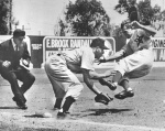 The trigger for the biggest brawl in PCL history. Hollywood Stars outfielder Ted Beard slides spikes-high into Los Angeles Angels third baseman Murray Franklin, August 2, 1953.