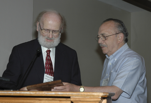 receives his McFarland-SABR Baseball Research Award from Len Levin, right, during the 2008 SABR convention in Cleveland, Ohio.