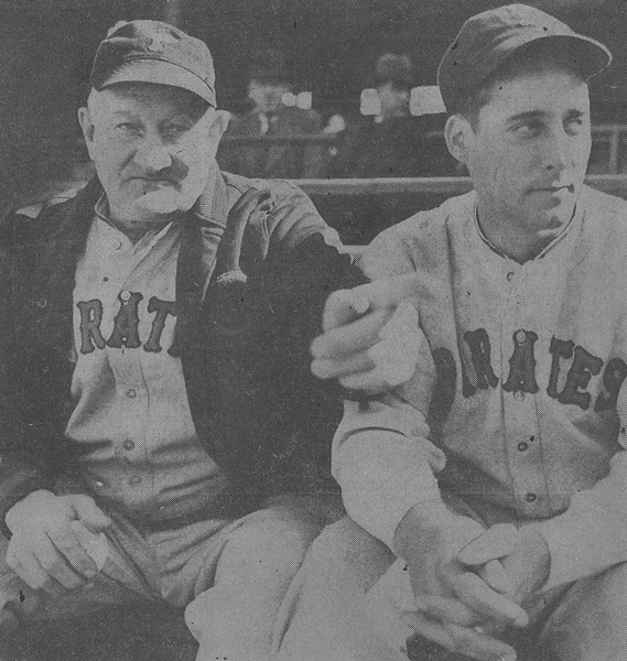 gives Johnny Rizzo (right), a promising Pittsburgh outfielder purchased from Columbus, a few pointers during an exhibition game.