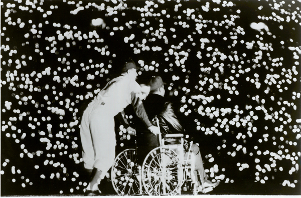 Pee Wee Reese pushes the wheelchair-bound ex-Dodgers catcher onto the Coliseum field on May 7, 1959.