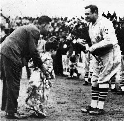 Presented with flowers before a game during the 1934 baseball tour of Japan.