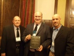 receives the Rocky Mountain Chapter's John Zajc Award. Pictured with John Paul (l) and Matt Repplinger (r).