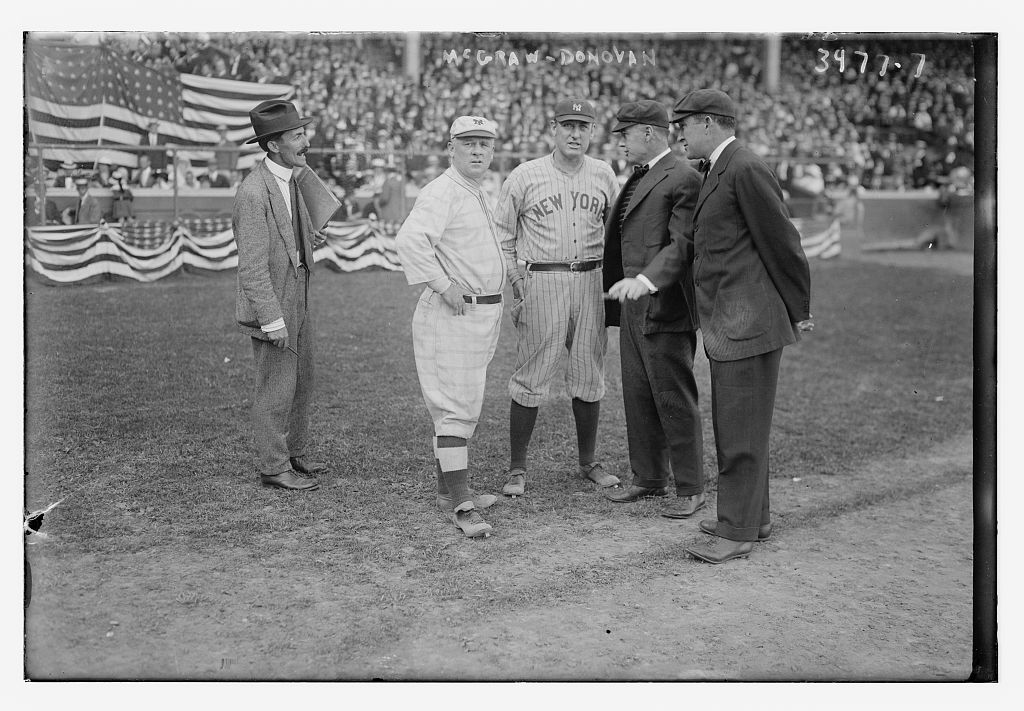 McGraw is pictured here in 1916 with Wild Bill Donovan, the manager of the New York American League club, and two umpires.