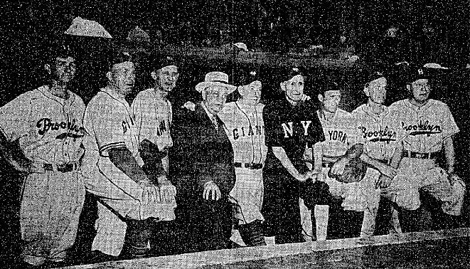 From left: Zack Wheat, Dodgers; Moose McCormick, Giants; Herb Pennock, Yankees; umpire Bill Klem; Roger Bresnahan, Giants; Hooks Wiltse, Giants; Wally Schang, Yankees; Nap Rucker, Dodgers; and Otto Miller, Dodgers.