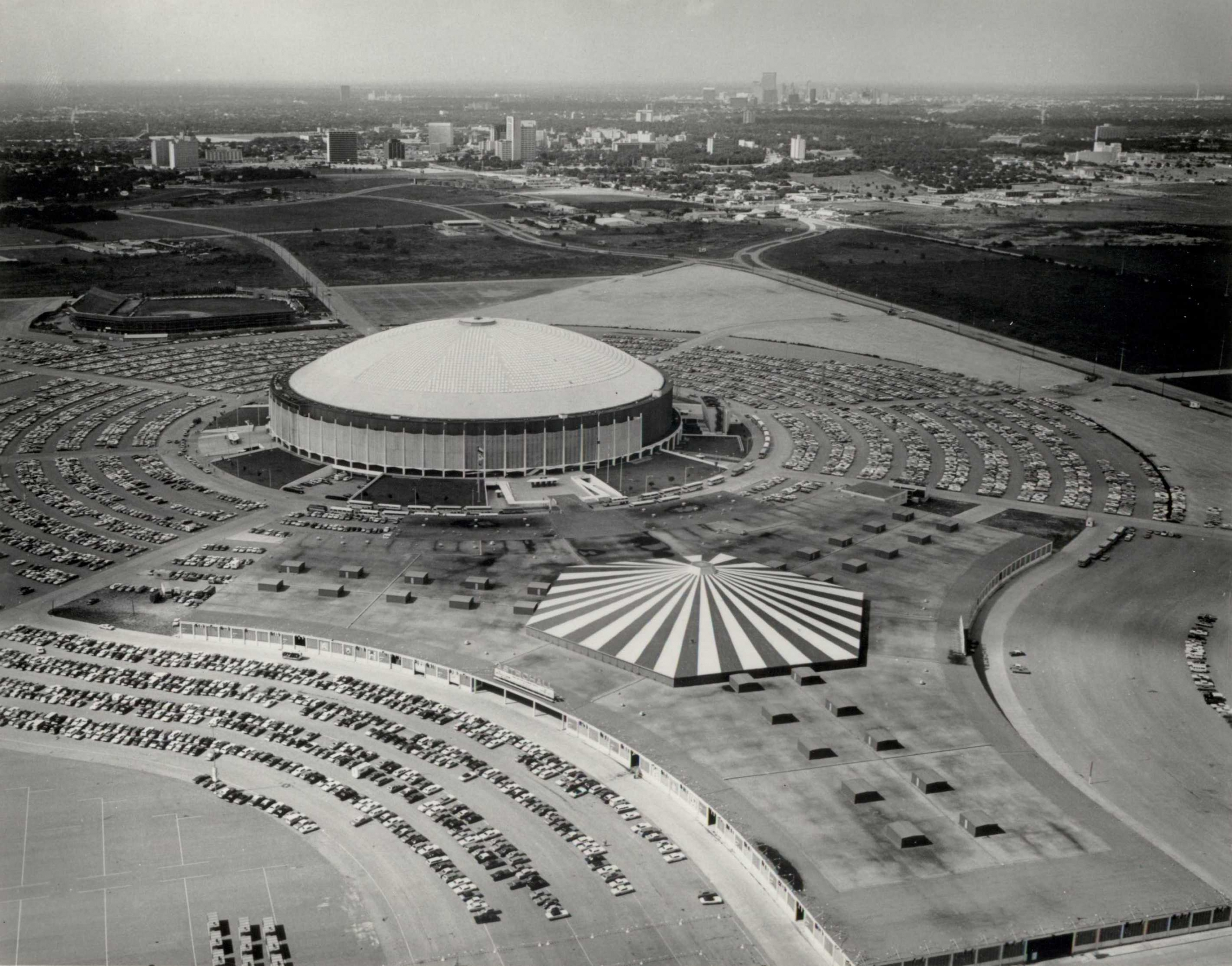 Near the Astrodome (with Colt Stadium in the background), a visitor from out of town could stay at the Astroworld Hotel, Astrodome Motor Inn, or Holiday Inn–Astroworld. For the kids there was the Astroworld amusement park, too.