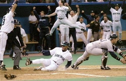 Ken Griffey Jr. slides home with the winning run in Game 5 of the 1995 ALDS (SEATTLE MARINERS)