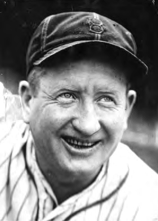 "He didn't ""dazzle"" in the minors while suffering from a chronic sore arm. In 1920, while pitching in New Orleans, he had surgery following a poker incident and found himself cured. He broke in as a 31-year-old rookie in 1922 with Brooklyn."