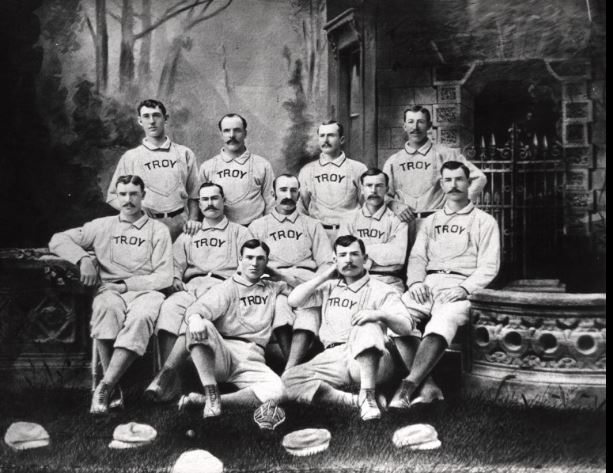 The 1881 and 1882 Trojans had three Hall of Famers: catcher Buck Ewing (rear, right) and hurlers Tim Keefe (next to Ewing) and Mickey Welch (rear, left).