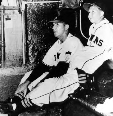 with manager Zack Taylor on the St. Louis Browns' bench in 1951.